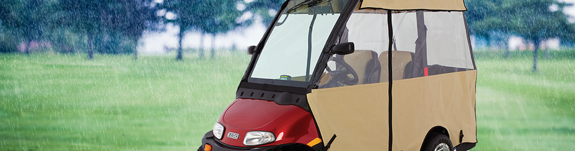 E-Z-GO Golf Cart with Windshield and Enclosure in Rain
